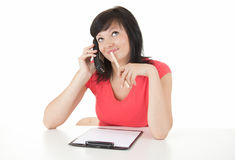 Young smiling businesswoman calling by phone Royalty Free Stock Images