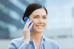 Young smiling businesswoman calling on smartphone Royalty Free Stock Photo