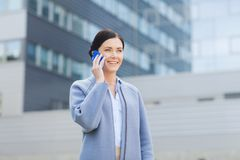 Young smiling businesswoman calling on smartphone Stock Photos