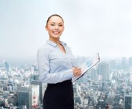 Young smiling businesswoman with clipboard and pen Royalty Free Stock Photography