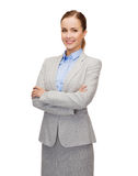 Young smiling businesswoman with crossed arms Stock Photos