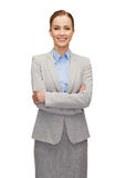 Young smiling businesswoman with crossed arms Royalty Free Stock Images