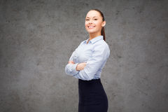 Young smiling businesswoman with crossed arms Stock Photo