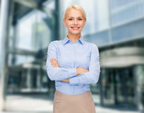 Young smiling businesswoman with crossed arms Stock Photography
