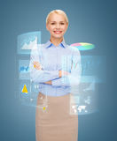 Young smiling businesswoman with crossed arms Stock Images
