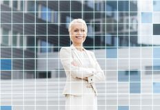 Young smiling businesswoman with crossed arms Royalty Free Stock Photo