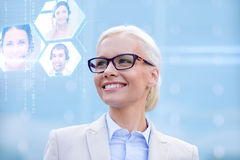 Young smiling businesswoman in eyeglasses outdoors Royalty Free Stock Images