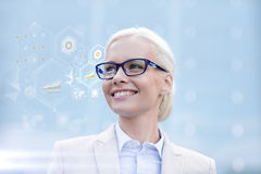 Young smiling businesswoman in eyeglasses outdoors Stock Photo