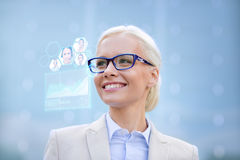 Young smiling businesswoman in eyeglasses outdoors Royalty Free Stock Photos