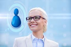 Young smiling businesswoman in eyeglasses outdoors Royalty Free Stock Image