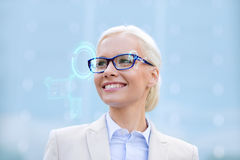 Young smiling businesswoman in eyeglasses outdoors Royalty Free Stock Photo