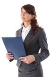 Young smiling businesswoman with folder look up Stock Images