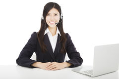 Smiling businesswoman with headset and laptop Stock Photos