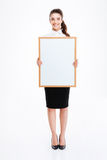 Young smiling businesswoman holding blank board Royalty Free Stock Images