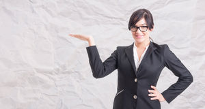 Young smiling businesswoman holding out her hand Royalty Free Stock Photo