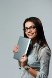 Young smiling businesswoman holding tablet computer Royalty Free Stock Photos