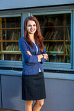 Young smiling businesswoman near the library Royalty Free Stock Image