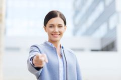 Young smiling businesswoman over office building Royalty Free Stock Images