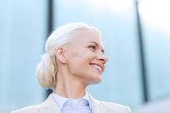 Young smiling businesswoman over office building Stock Photos