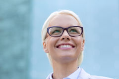 Young smiling businesswoman over office building Royalty Free Stock Photography
