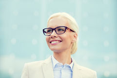 Young smiling businesswoman over office building Stock Photo