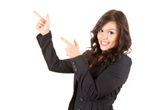 Young, smiling businesswoman pointing up Stock Images
