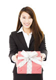 Young smiling businesswoman  showing the gift box Stock Photos