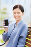 Young smiling businesswoman showing smartphone Royalty Free Stock Photography