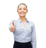 Young smiling businesswoman showing thumbs up Royalty Free Stock Photos