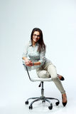 Young smiling businesswoman siiting on the office chair stock image