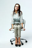 Young smiling businesswoman sitting on office chair Royalty Free Stock Images
