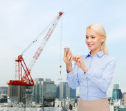 Young smiling businesswoman with smartphone Stock Photos