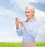 Young smiling businesswoman with smartphone Royalty Free Stock Image