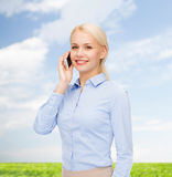 Young smiling businesswoman with smartphone Stock Image