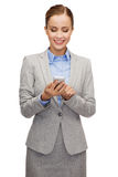 Young smiling businesswoman with smartphone Royalty Free Stock Photography