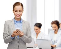 Young smiling businesswoman with smartphone Royalty Free Stock Images