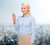 Young smiling businesswoman with smartphone Stock Images