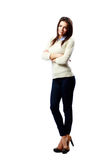Young smiling businesswoman standing with arms crossed Royalty Free Stock Image