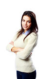 Young smiling businesswoman standing with arms folded Stock Photography