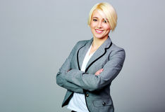 Young smiling businesswoman standing with arms folded Royalty Free Stock Image