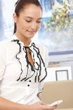 Young smiling businesswoman texting Royalty Free Stock Image