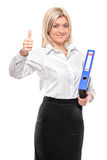 Young smiling businesswoman with thumbs up Stock Photo