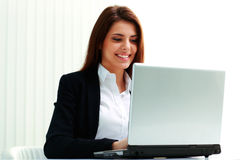 Young smiling businesswoman typing on the laptop Stock Photos