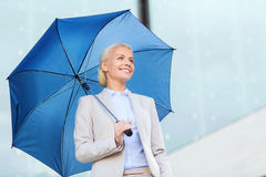 Young smiling businesswoman with umbrella outdoors Royalty Free Stock Images