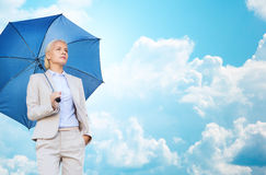 Young smiling businesswoman with umbrella outdoors Royalty Free Stock Photos