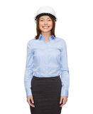 Young smiling businesswoman in white helmet Royalty Free Stock Photos