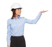Young smiling businesswoman in white helmet Stock Photos
