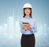 Young smiling businesswoman in white helmet Stock Images