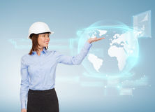 Young smiling businesswoman in white helmet Stock Image
