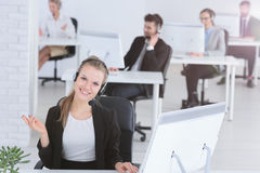 Call center agent. Young smiling call center agent at work stock images